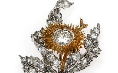 A diamond brooch set with an old brilliant-cut diamond encircled by numerous diamonds mounted in...