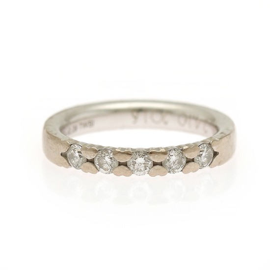 A diamond eternity ring set with four brilliant-cut diamonds, mounted in 14k white gold. Size 53.