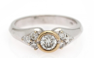 NOT SOLD. A diamond ring set with a diamond weighing app. 0.34 ct. flanked by...