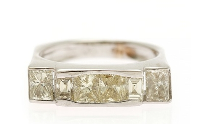 A diamond ring set with two princess-cut, two rectangular princess-cut and two baguette-cut diamonds, totalling app. 2.00 ct., mounted in 14k white gold.
