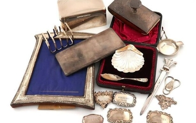 A mixed lot of silver items, comprising: a cased butter dish and spoon, of shell form, Sheffield 1894, a modern money clip, by Asprey, London 1968, engraved with Prince of Wales feathers, a paper knife, with a Prince of Wales feathers terminal, a...