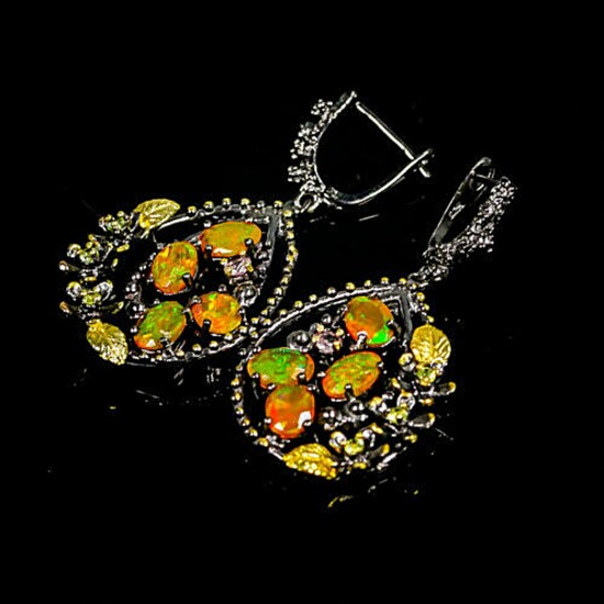 A pair of ear pendants each set with numerous cabochon opals and circular-cut tourmalines and peridots, mounted in black rhodium and gold plated sterling silver