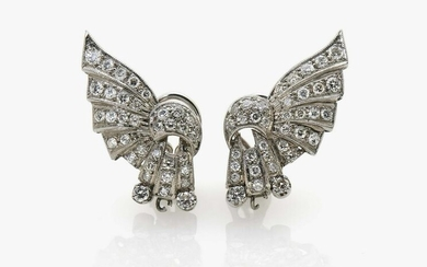 A pair of fan-shaped stud earrings with brilliant cut
