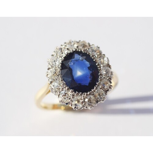 A sapphire and diamond cluster ring, the central oval, mixed...