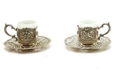 A set of German silver coffee can holders and saucers