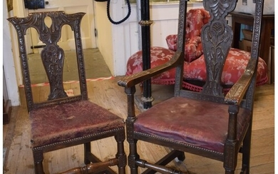 A set of eight 18th century style oak dining chairs, carved ...