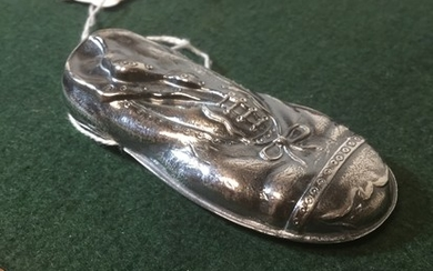 A silver plated vesta, in the form of a boot