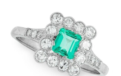 AN EMERALD AND DIAMOND DRESS RING set with an emerald
