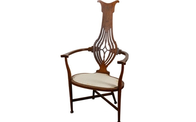 An Edwardian Art Nouveau oak and marquetry inlaid open armchair