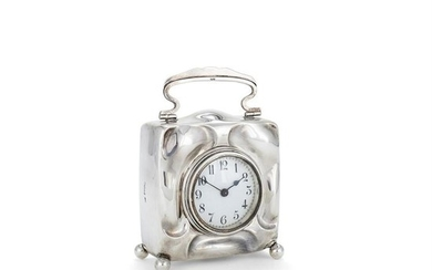 An Arts and Crafts silver desk clock by William Neale