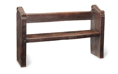 An Elizabeth I oak pew, or bench, circa 1560