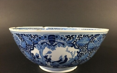 CHINESE BLUE AND WHITE LOTUS BOWL painted with a birds in br...