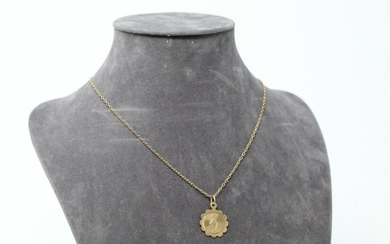 Chain with chain link and religious medal in 18k (750) yellow gold.