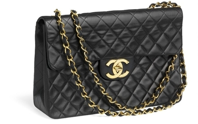 "Chanel: A ""Maxi Jumbo Flap Bag"" of black quilted leather, golden hardware, CC turn lock and double chain strap."