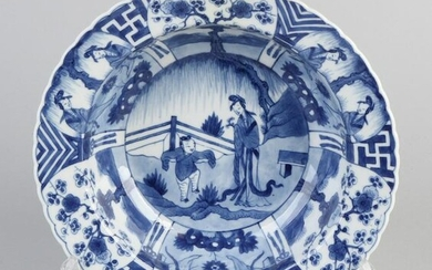 Deep Chinese porcelain dish with garden figures and