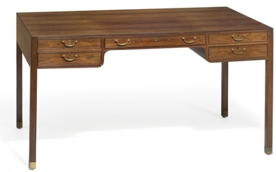 """Jacob Kjær: Freestanding Brazilian rosewood desk with """"shoes"""" of brass. Front with five profiled drawers with brass handles."""