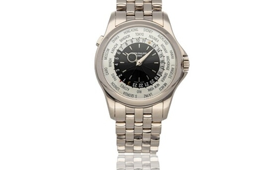 PATEK PHILIPPE   WORLD TIME REF 5130/1G, A WHITE GOLD AUTOMATIC WORLD TIME WRISTWATCH WITH BRACELET CIRCA 2017
