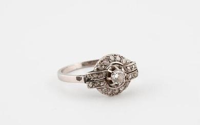 Platinum ring (850) set with a half-cut diamond in claw setting in a ring of rose-cut diamonds in grain setting.