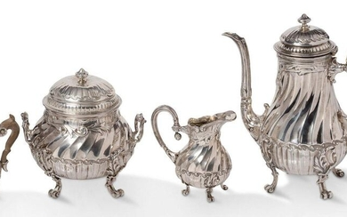 ~Silver torso-rimmed service consisting of a teapot with an ivory ringed handle, a sugar bowl and a milk jug in the form of a baluster with a rocaille decoration of post friezes and acanthus leaves, resting on four scrolled feet. Goldsmith's illegible...
