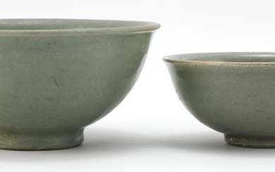 """THREE CHINESE BOWLS 1-2) Two celadon stoneware bell-form bowls, one with incised wave design. Diameters 6.75"""" and 8.25"""". 2) Blue and..."""