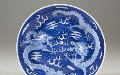 """Two Chinese blue and white porcelain """"Dragon"""" dishes late..."""