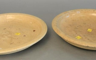 Two early Asian glazed chargers, each having off white