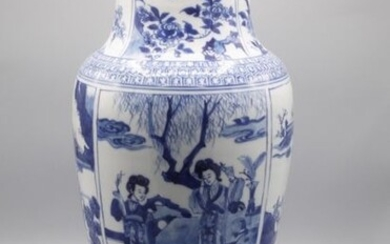White blue Chinese porcelain vase decorated with court scenes in storerooms.