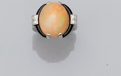 White gold ring, 750 MM, decorated with a cabochon opal weighing about 7 carats between two onyx motifs and two diamond bars, total dimensions 19 x 16 mm, opal , size : 54, weight : 7,9gr. rough.