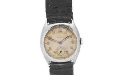 Rolex. A mid-size stainless steel manual wind tonneau form wristwatch