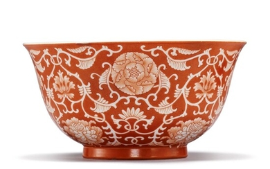 A CORAL-RED RESERVE-DECORATED 'FLORAL' BOWL, QIANLONG SEAL MARK AND PERIOD