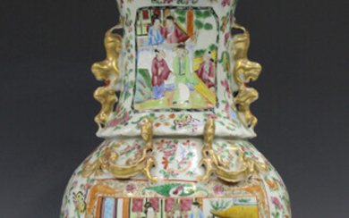 A Chinese Canton famille rose porcelain vase, mid-19th century, the shouldered ovoid body and flared