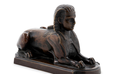 A Continental Grand Tour Patinated Bronze Sphinx