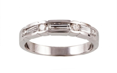 A DIAMOND HALF ETERNITY RING, with round and baguette cut di...