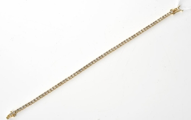A DIAMOND LINE BRACELET, THE TOTAL DIAMOND WEIGHT ESTIMATED 4.60CTS, IN 18CT GOLD, LENGTH 185MM, 7.7GMS