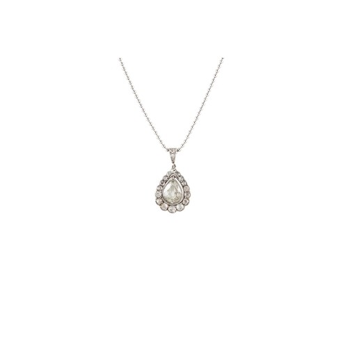 A DIAMOND SET CLUSTER PENDANT, the pear shaped diamond to an...