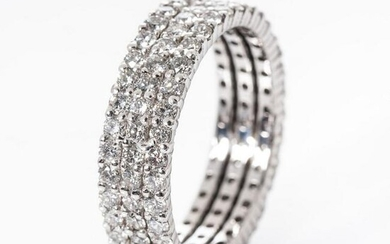 A DIAMOND TRIPLE ROW ETERNITY RING