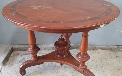 A MAHOGANY AND WALNUT CENTRE TABLE