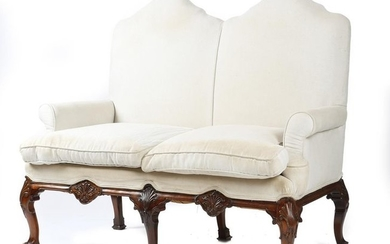 A MAHOGANY TWO SEATER SETTEE IN GEORGE II...