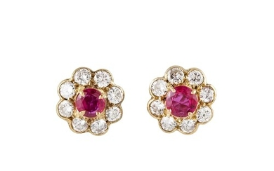 A PAIR OF RUBY AND DIAMOND CLUSTER EARRINGS, the circular ru...