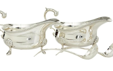 A PAIR OF STERLING SILVER GEORGIAN STYLE GRAVY BOATS
