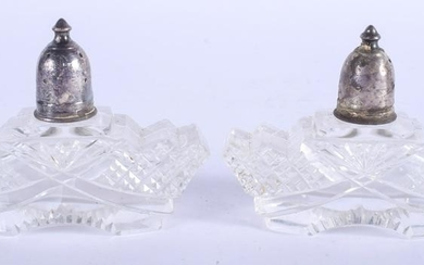 A PAIR OF VINTAGE SILVER TOPPED GLASS SALTS. 9 cm wide.