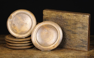 A Set of Six Swedish Treen Plates with moulded borders, branded underneath with initials J.O.J.S., a