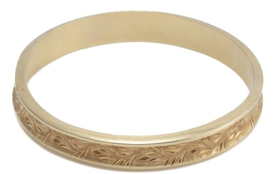 A VINTAGE 14CT GOLD BANGLE; 10.6mm wide hollow bangle of concave form with engraved decoration and Austro Hungarian hallmarks, inter...