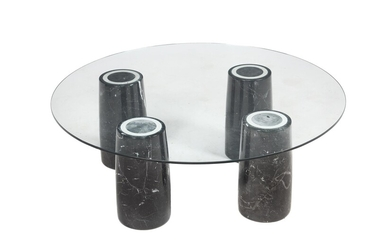 A glass and marble low centre table