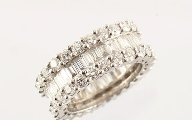 A good white gold diamond eternity ring, set with a ring of ...