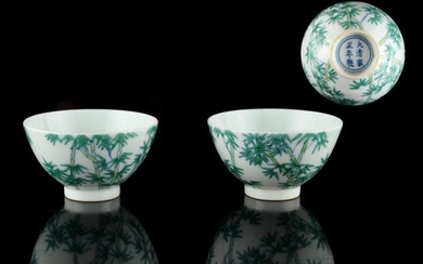 A pair of Chinese doucai wine cups, each painted...