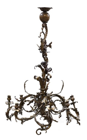 A pair of French rococo-style gilt bronze eight-light chandeliers