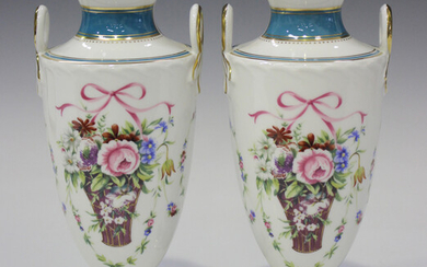 A pair of Minton Bicentenary Rose Basket two-handled vases of shield shape, decorated with flower ba