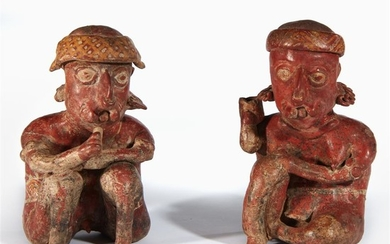 A pair of Nayarit painted terracotta seated figures 100...