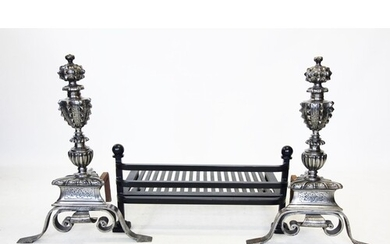 A pair of Puginesque Gothic revival chromed metal fire dogs,...